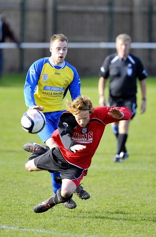 Campion's Steven Barge tumbles under pressure from Salts' Jonny Cunnington
