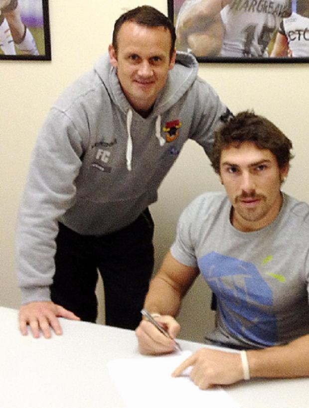 Jarrod Sammut, pictured signing his new deal, says players know exactly where they stand with straight-talking Francis Cummins