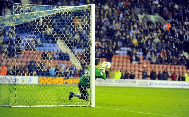 Matt Duke saves the shoot-out penalty that earned City a Capital One Cup quarter-final berth