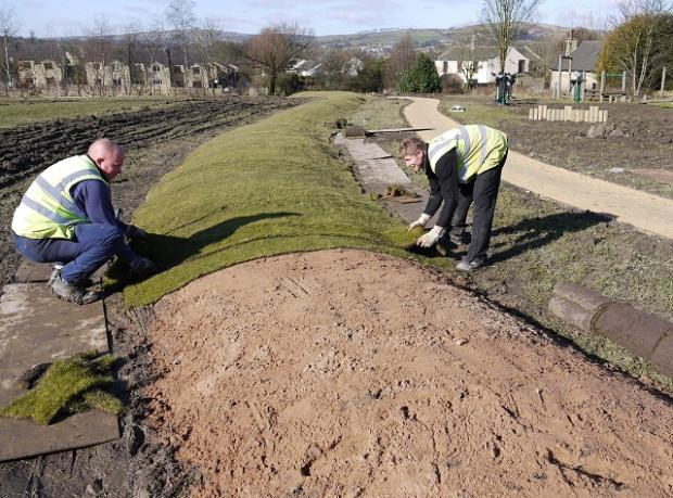 Landscape Engineering contractors lay the turf on the mounds at Eastburn Recreation Ground, near Keighley