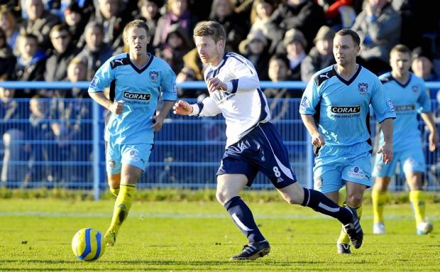 The second yellow for Danny Boshell, pictured centre, was 'petty' according to Guiseley boss Steve Kittrick