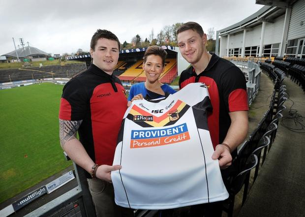 Bulls players John Bateman, left, and Elliott Whitehead, right, with Provident head of marketing Lindsey Orme