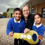 Pupils Bilal Hussain and Eisha Khan and headteacher Sarah Dawson at the hand-over of the extension