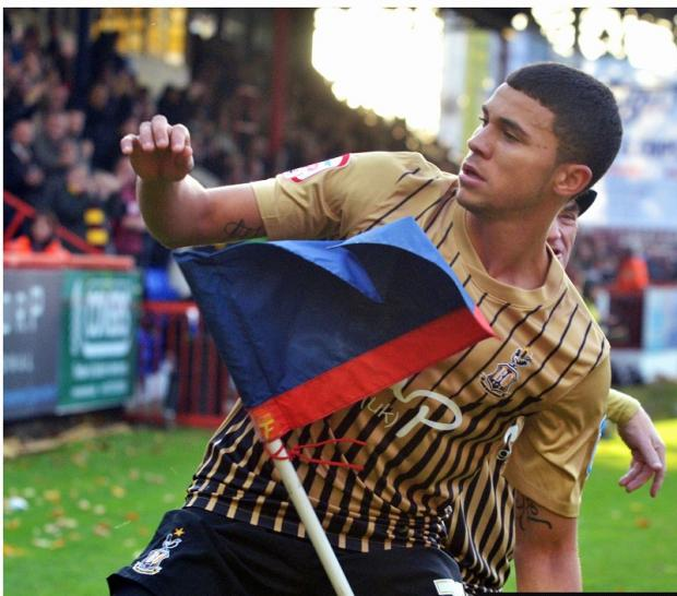 Nahki Wells kicks the corner flag in celebration after his first goal