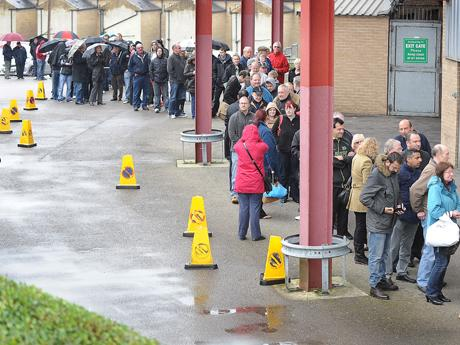 Bradford City fans queue around the block for Arsenal tickets