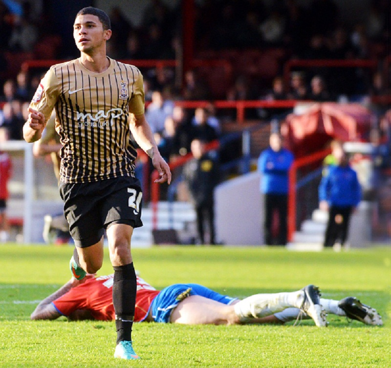 Aldershot defender Sonny Bradley can't bear to look after Nahki Wells pounced on his mistake to score the first of his two goals at the EBB Stadium on Saturday