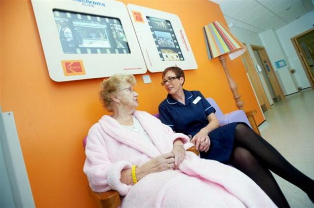 Clinical services manager Debbie Beaumont with a patient in the refurbished dementia care ward at BRI