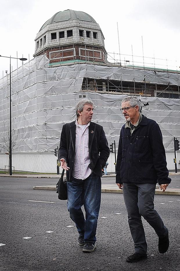 Griff Rhys Jones and Gideon Seymour walking past the Odeon building