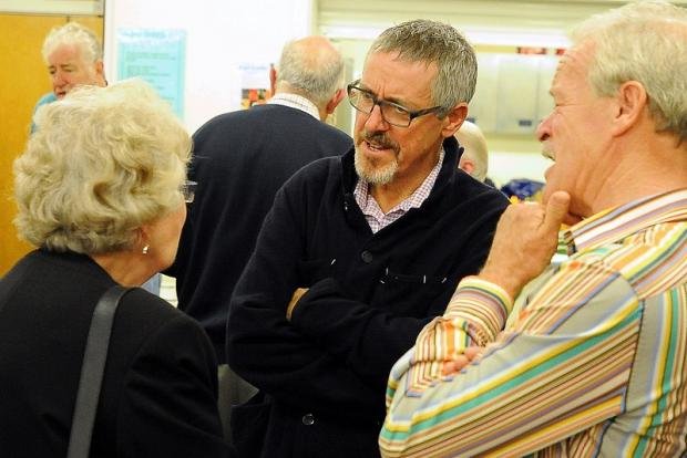 SUPPORT: People at last night's meeting discuss the green spaces issue with the actor Griff Rhys Jones