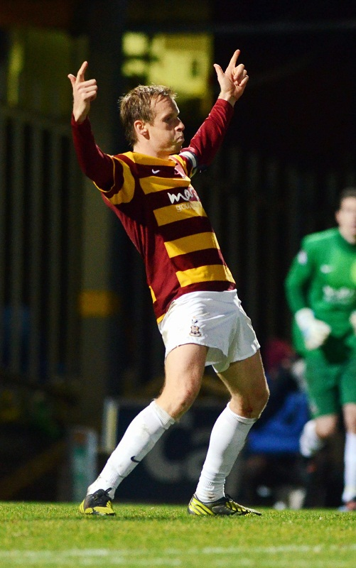 Ricky Ravenhill celebrates after converting the decisive penalty