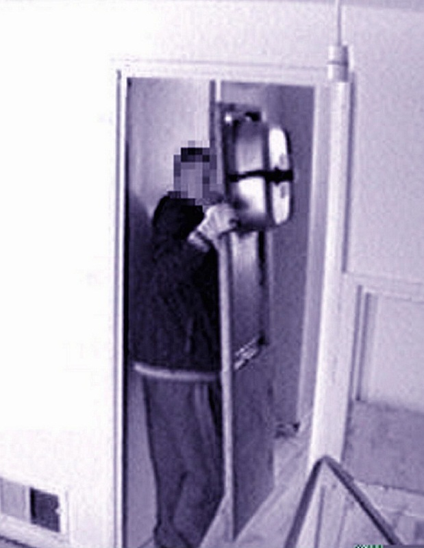 Daniel Patchett caught on CCTV stealing the kitchen sink from the police ca
