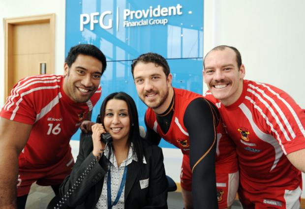 Bulls players Manasase Manuokafoa, Matt Diskin and Heath L'Estrange with receptionist at Provident Kiren Sohal when they popped in for lunch at the HQ of their new sponsors