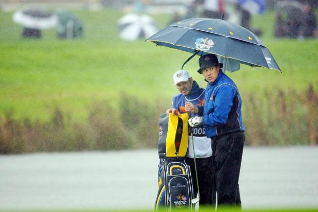 Great mates Billy Foster and Lee Westwood at work during the 2010 Ryder Cup at Celtic Manor
