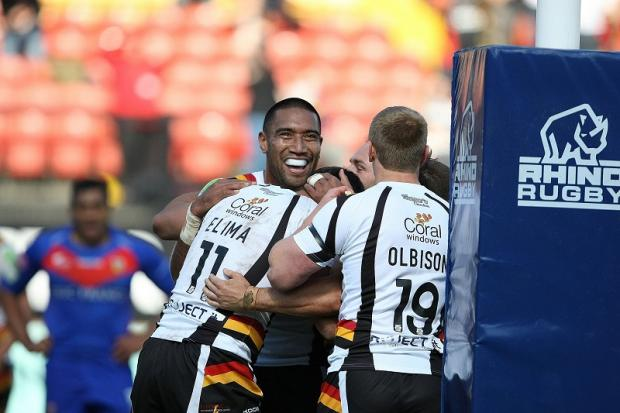 The Bulls beat Wakefield  34-26 at Odsal in last season's fixture. Pictured is try-scorer Olivier Elima being congratulated by Manase Manuokafoa