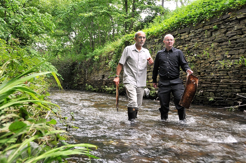 Barney Lerner (left) and Michael Canning in the Bradford Beck near Cemetery Road, Bradford