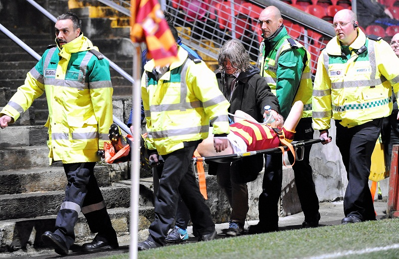 On-loan City defender John Egan leaves the pitch on a stretcher after suffering a suspected broken leg