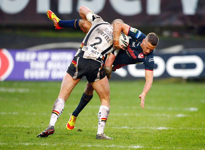 Jamie Foster is felled by Adrian Purtell during the Odsal match that effectively ended his St Helens career