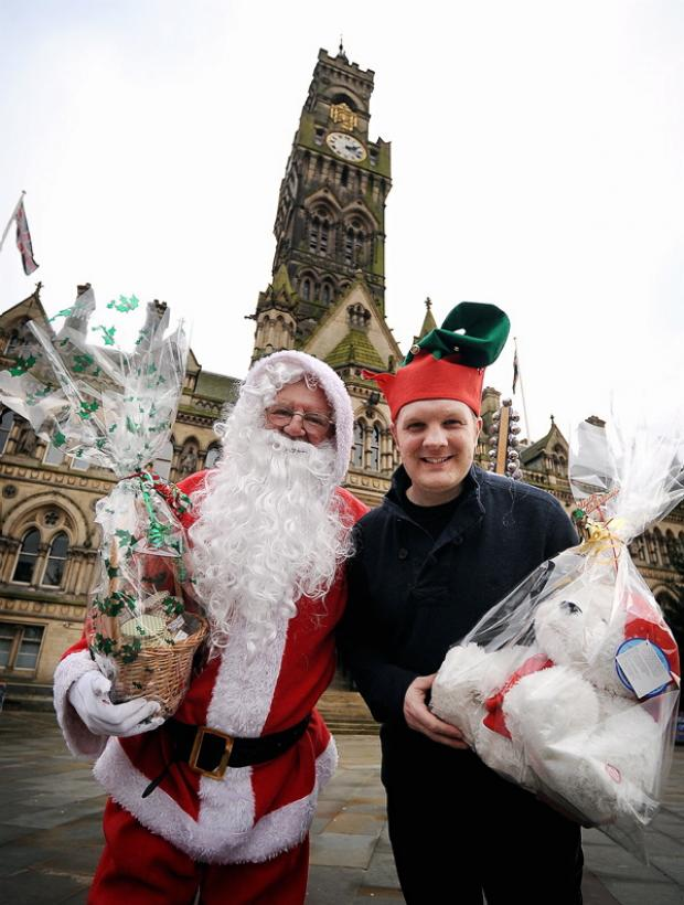 Father Christmas and Martin Bradnam encouraging people to visit the market