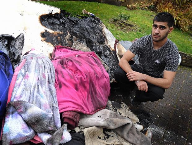 Sahrib Hameed surveys the aftermath of the blaze at the family house