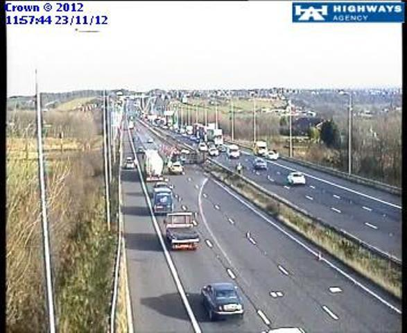 The overturned vehicle can be seen on the M62