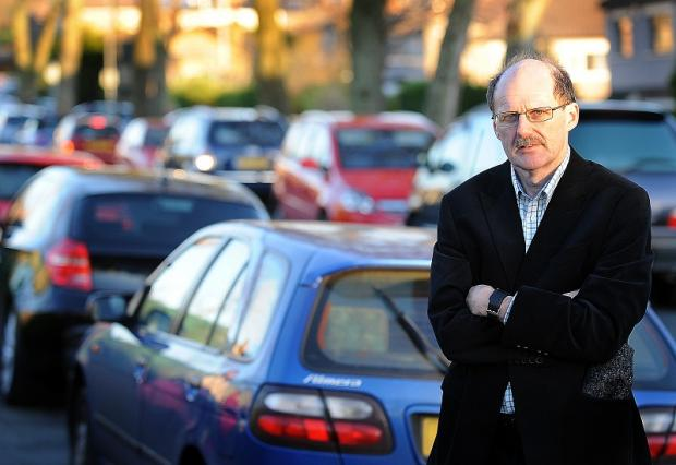 Bradford Telegraph and Argus: Councillor Howard Middleton outside Grove House Primary School