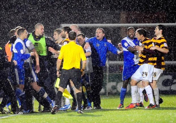Phil Parkinson tries to help restore order as Nathan Doyle is held back during the fracas that resulted in the City midfielder being sent off