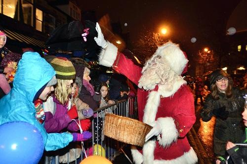Bradford Telegraph and Argus: JOY: Santa hands out goodies at Ilkley lights switch-on