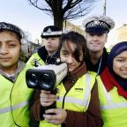 Bradford Telegraph and Argus: Pupils from St Andrew's Primary School, Keighley, join PCSO Kirsty Newton and PC Richard Hirst in the speed-checking session on West Lane, Keighley. From left are Ayesha Arif, Esha Rukhsar and Zainab Ali