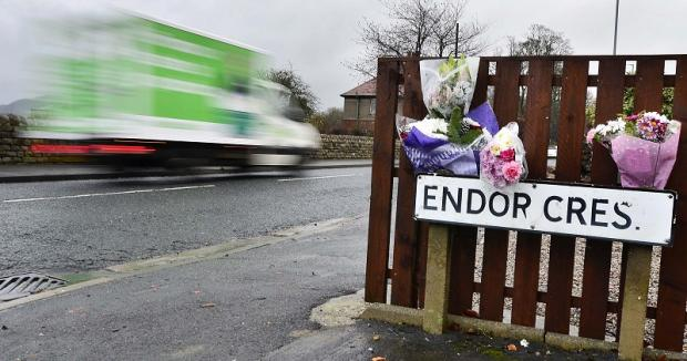 A road sign near the scene of the fatal accident.