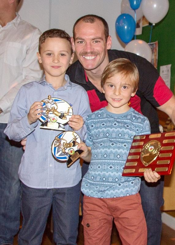 Heath L'Estrange presents awards to under-sevens pair Ben Redmond and Kyle Wroe during Birkenshaw Juniors' prize presentation evening