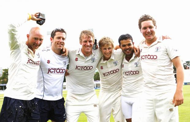 We've done it. From left, Adam Lyth, physio Scot McAllister, Steve Patterson, Joe Root, Azeem Rafiq and Garry Ballance celebrate Yorkshire's promotion back to Division One of the LV= County Championship