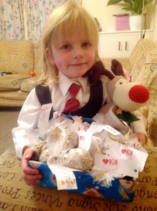 Olivia Wilkinson with parcelled-up bags of 'reindeer food' to sell