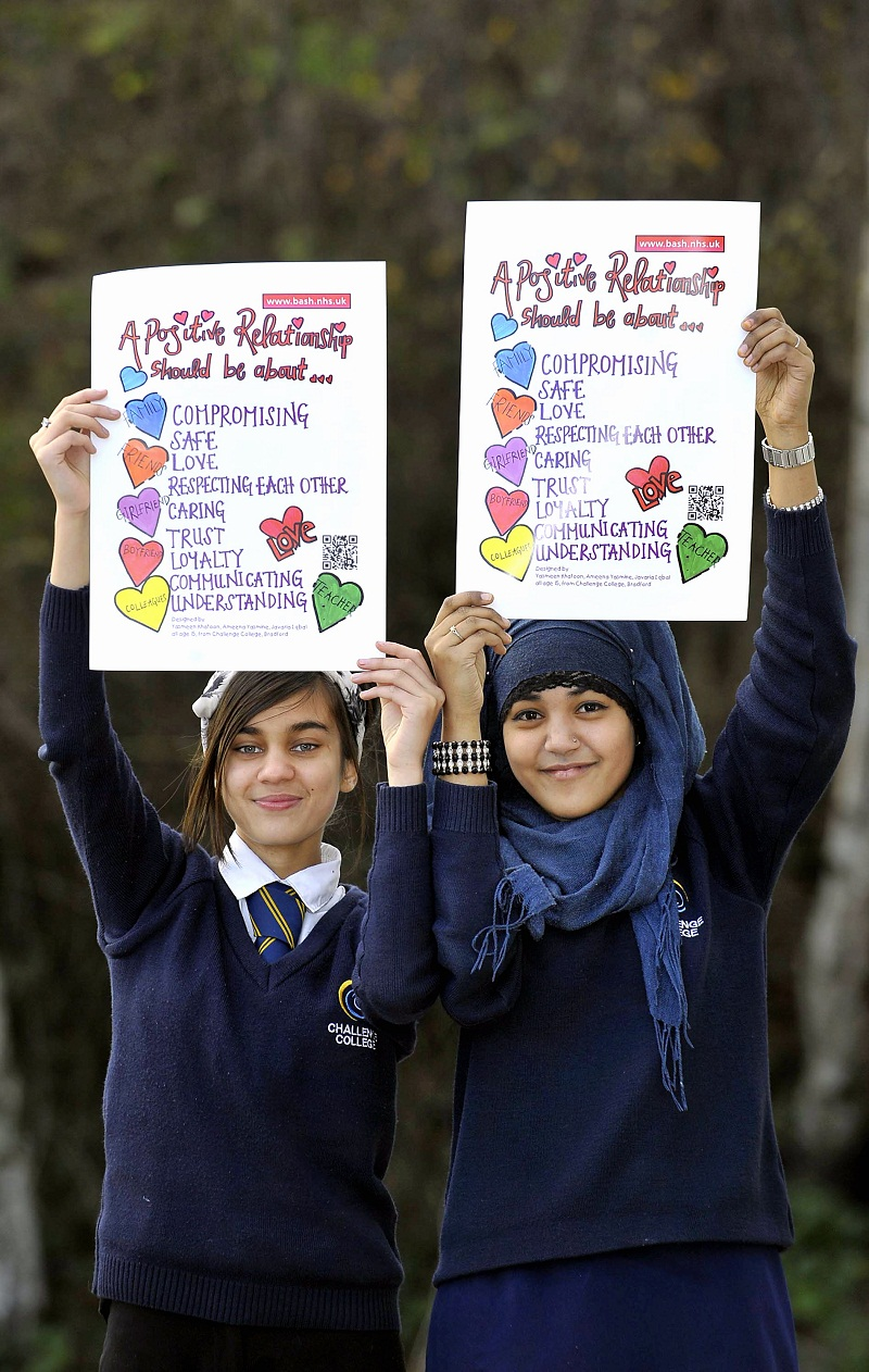 WINNERS: Javaria Iqbal (left) and Yasmeen Khatoon from Challenge College with their poster design