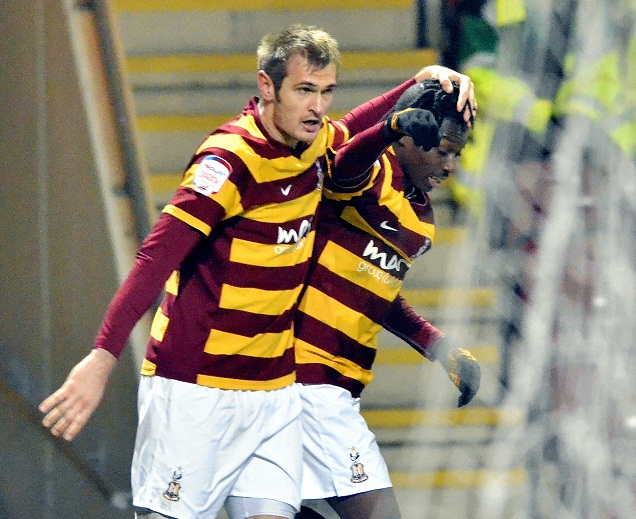 City goalscorer James Hanson celebrates his goal with Blair Turgott