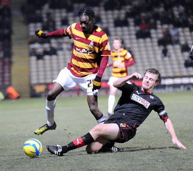 Bradford Telegraph and Argus: Blair Turgott in action for City during his senior debut on Friday night