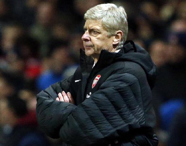 THEY'RE WOBBLING: Arsene Wenger cut a forlorn figure against Swansea on Saturday, when a 2-0 home defeat saw them plummet to tenth in the Premier League