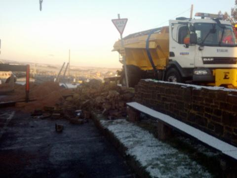 Gritter overturns in icy conditions