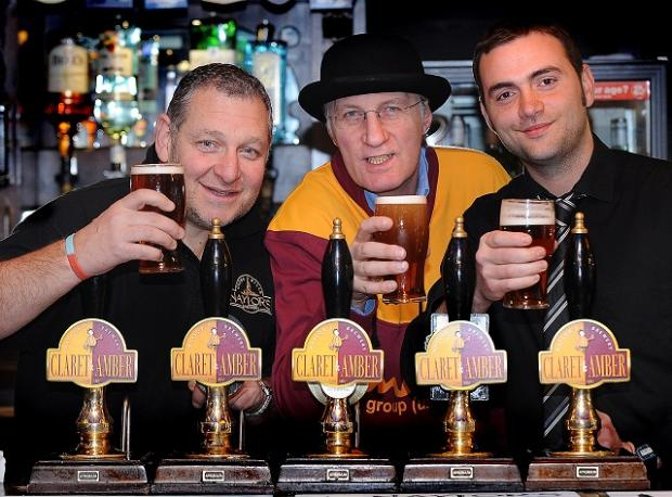 Jeff Wilson, Naylor's Brewery, Mike Harrison, Editor of City Gent and Ben Rothwell, manager at City Vaults, with pints of Claret and Amber Ale ahead of Bradford City's League Cup match against Arsenal