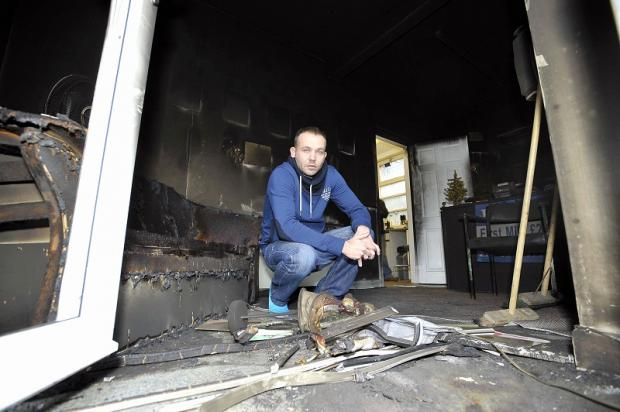 New private hire firm boss Lee Frear surveys the damage to his HQ