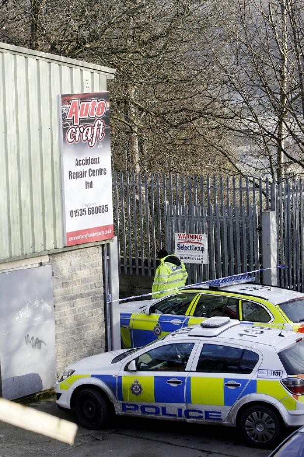 Police at the car repair workshop in Keighley