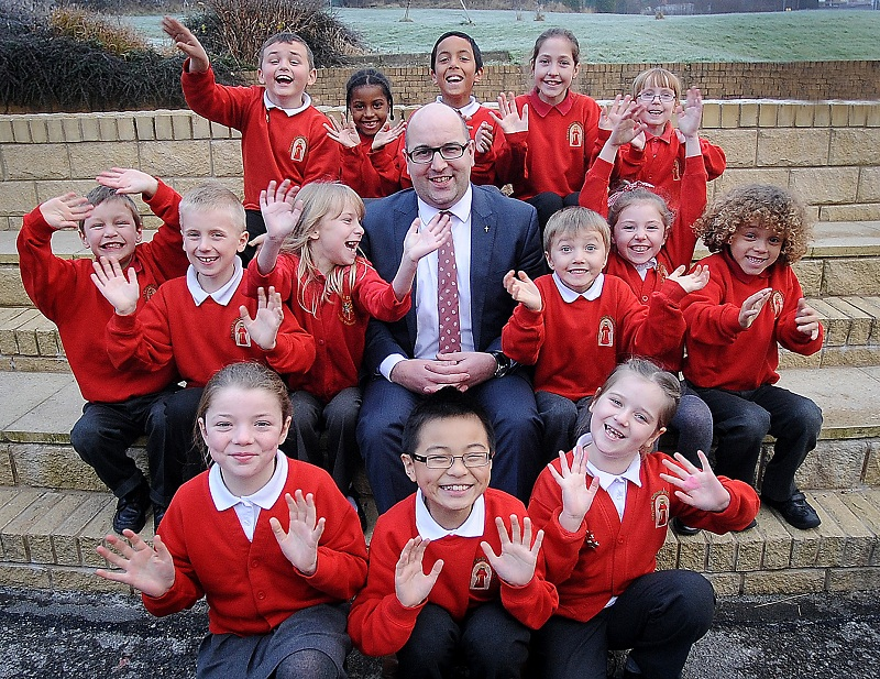 St Francis Catholic Primary School head teacher, Daniel Copley, with pupils