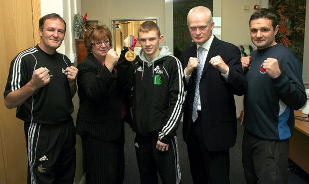 From left, Bradford College AASE boxing programme coach Kevin Smith, College principal Michele Sutton, College boxing development officer Paul Porter and College coach Mally MacIver celebrate the gold-medal success of Olly Simpson, centre