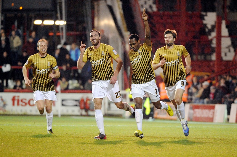 Kyel Reid celebrates scoring in his City comeback match but it was not enough to earn an FA Cup victory at Brentford