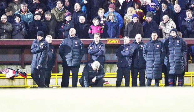 There were plenty of glum faces on the Arsenal bench as they lost at Valley Parade