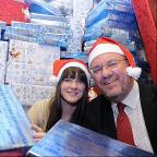 Bradford Telegraph and Argus: Sarah Gate  from the   Human Relief Foundation and Telegraph and Argus Editor Perry Austin-Clarke, with the Secret Santa presents