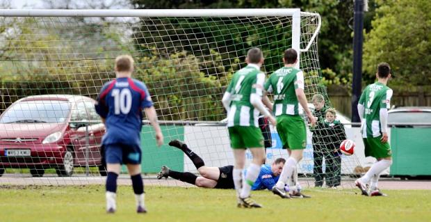 John Lamb makes a save for Avenue before his retirement at the end of last season