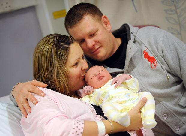 Laura Holmes and Darren Hunt with baby Kayne Thomas Hunt