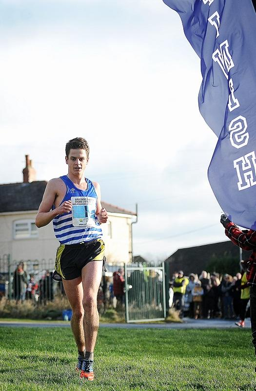 Jonny Brownlee crosses the line to maintain his family's dominance of the Chevin Chase