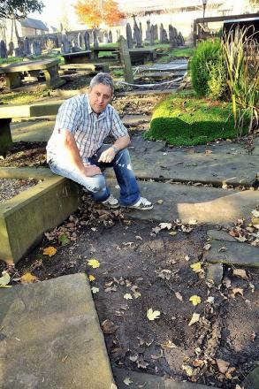 Steven Stanworth at the site of the missing gravestones