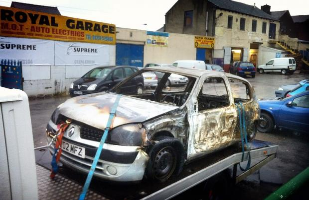 One of the cars damaged in the arson attack